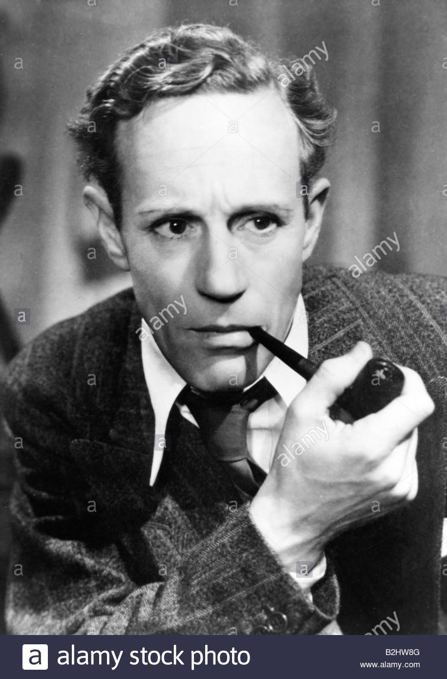 Howard, Leslie, 3.4.1893 - 1.6.1943, British actor, smoking pipe, 1930s / 1940s, Additional-Rights-Clearances-NA - Stock Image