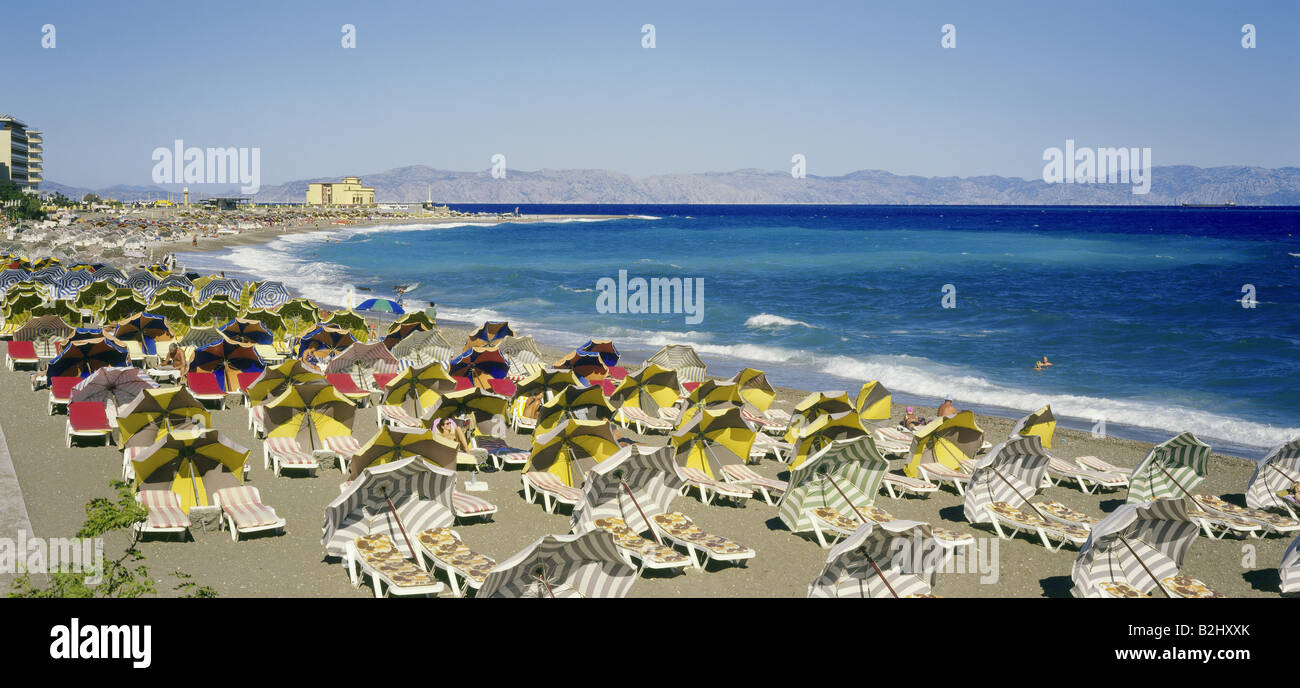 geography / travel, Greece, Island Rhodes, Rhodes town, beach, sea, parasol, mass tourism, holiday, holidays, vacation, - Stock Image