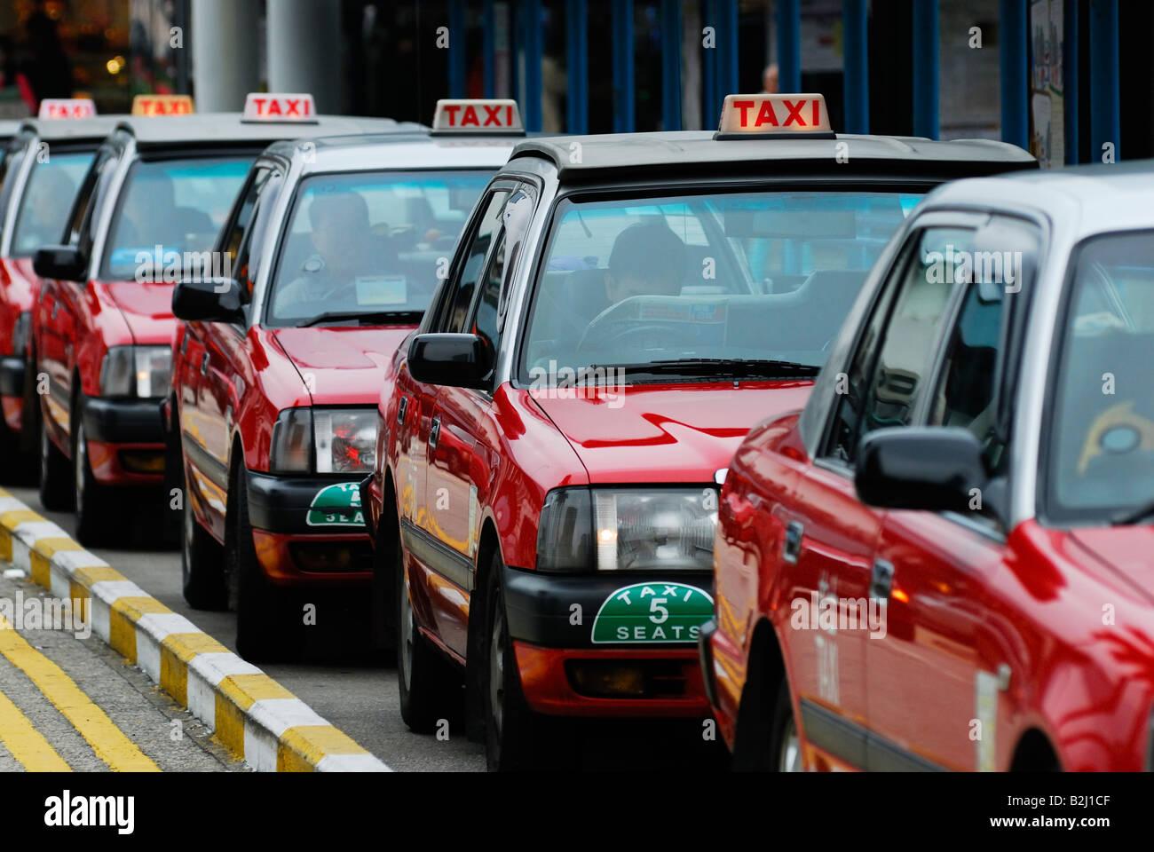 red cubs taxis Kowloon Hongkong Hong Kong - Stock Image
