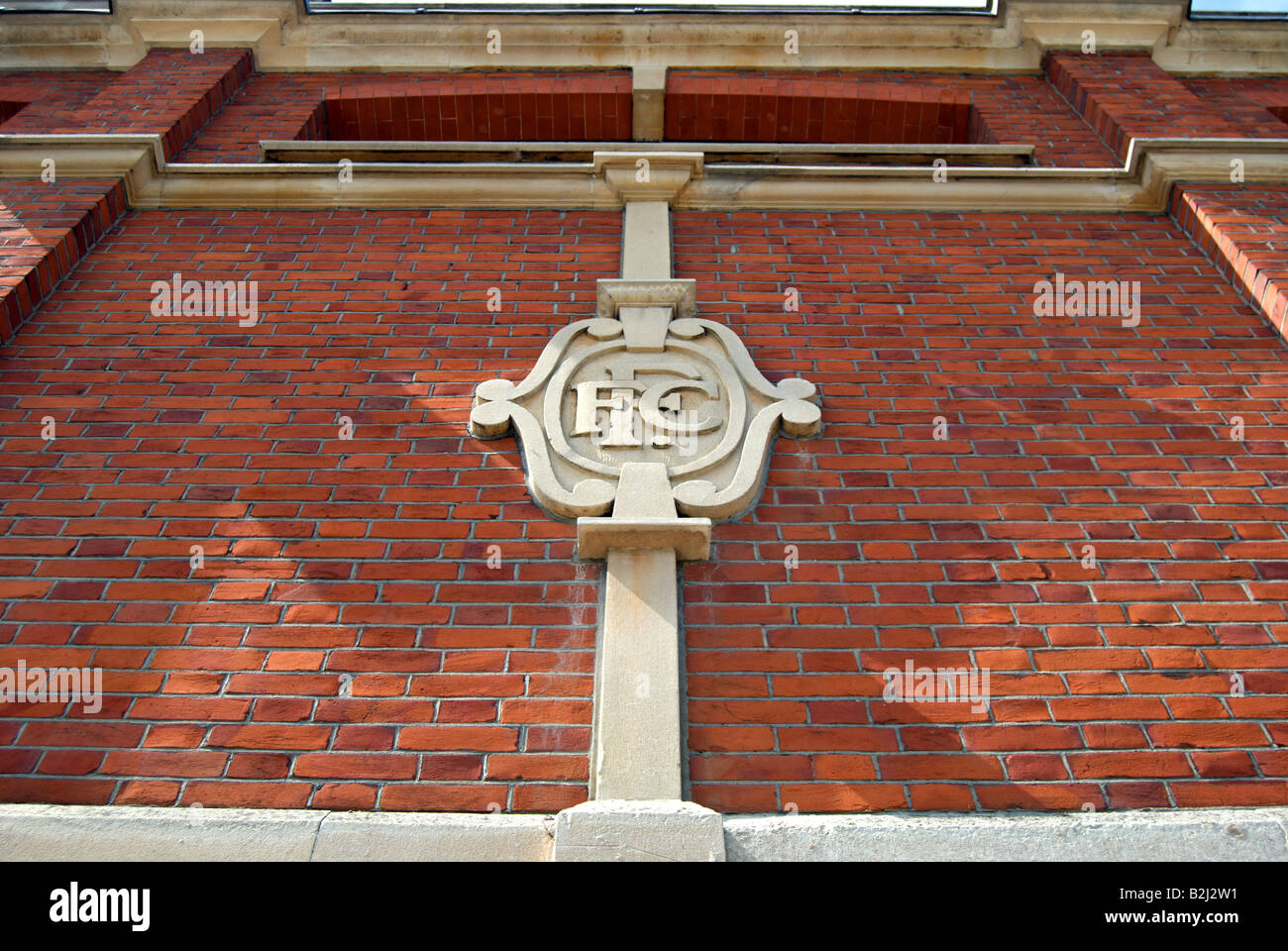 crest of fulham football club on the exterior of the johnny haynes stand at craven cottage, southwest london, england - Stock Image