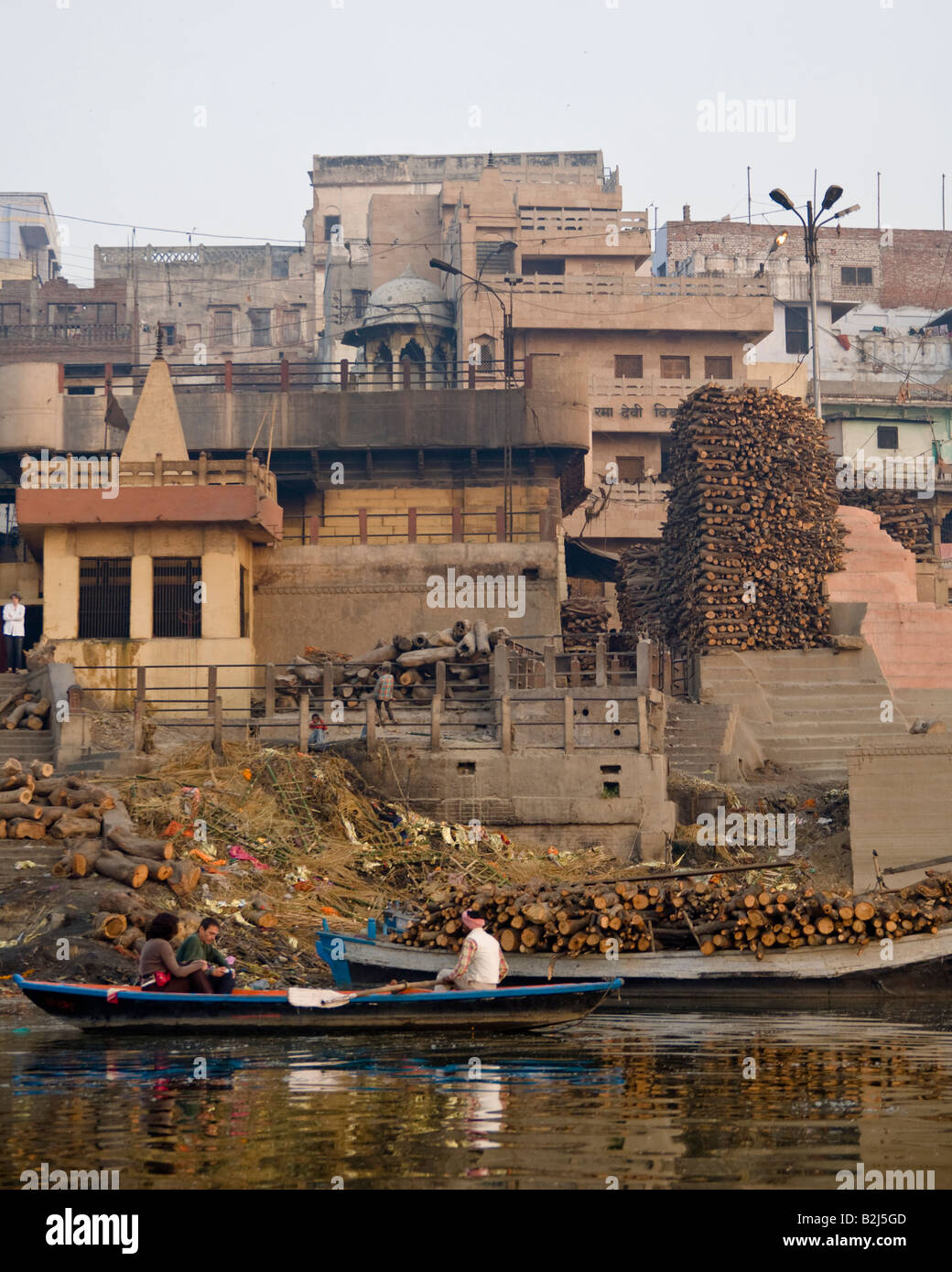 Piles of wood used for open air cremations at the ancient city of Varanasi on the banks of the river Ganges, India. Stock Photo