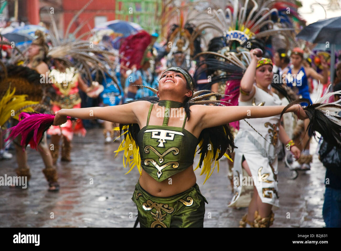Mexican Women Dance In Aztec Indian Costumes In The Festival De San B J on Aztec Indian Dancers