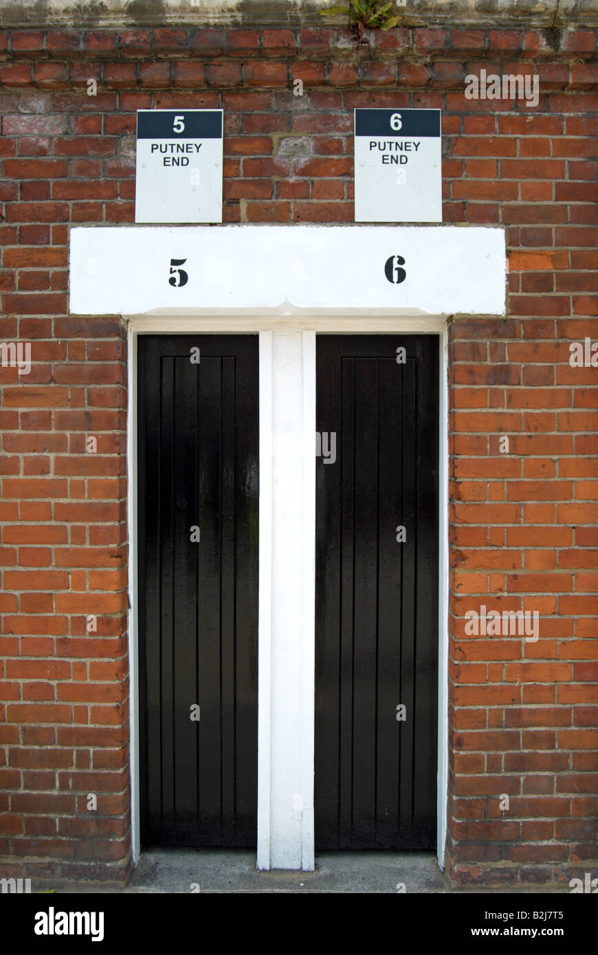 adjoining pair of closed turnstile entrances at at craven cottage, home of fulham football club, southwest london, - Stock Image