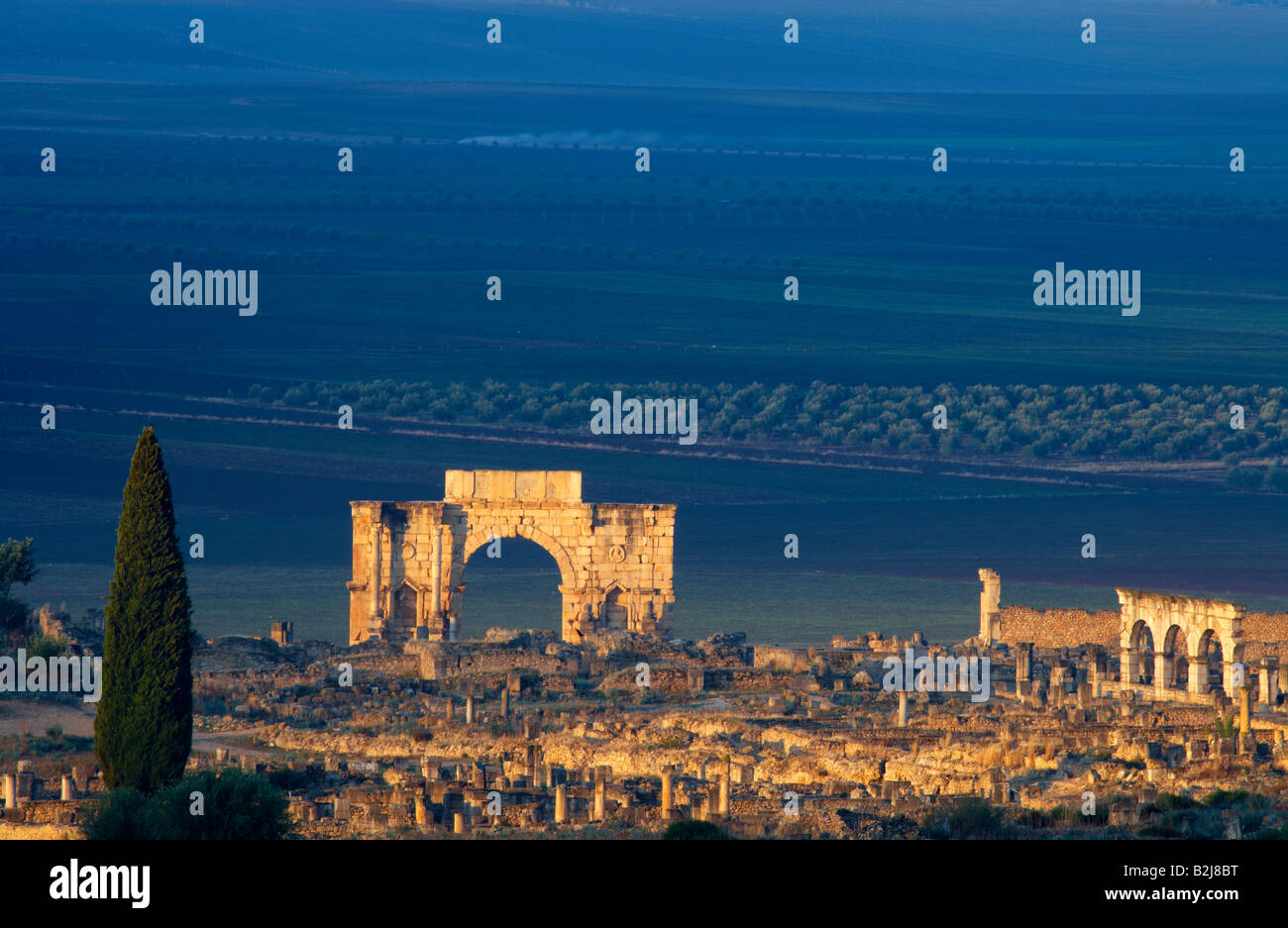 the Triumphal Arch in the ancient Roman ruins at Volubilis, Morocco - Stock Image