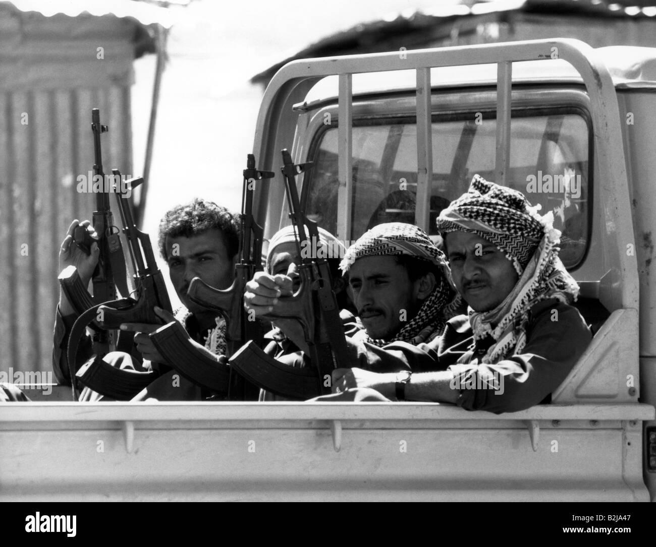 military, Yemen, sldiers on a truck, 1998, weapons, assault rifle, AK47, AK 47, AK-47, Kalashnikov, Arabs, Arabia, - Stock Image