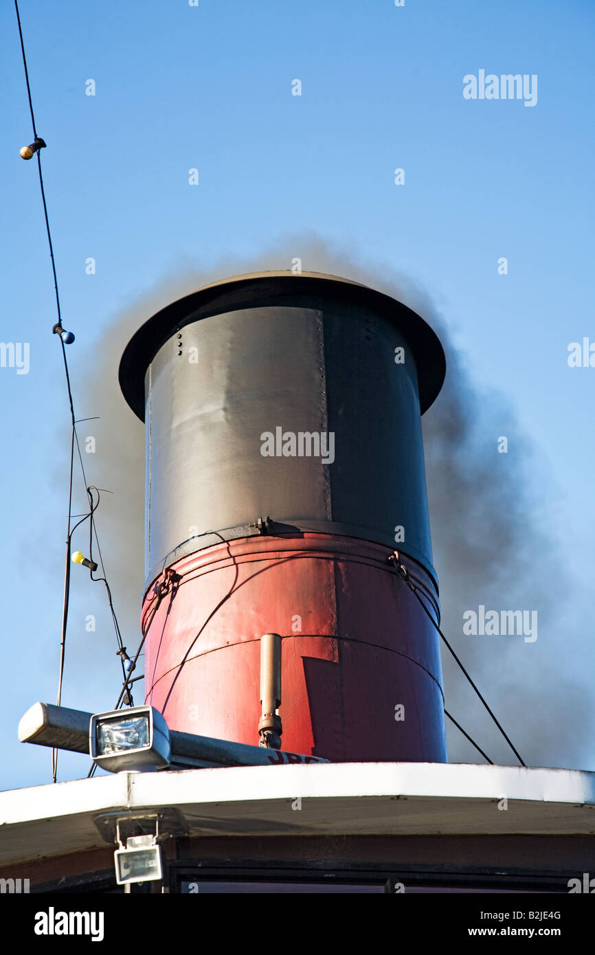 STEAM SHIP FUNNEL WITH SMOKE LAKE WAKATIPU QUEENSTOWN SOUTH ISLAND, NEW ZEALAND - Stock Image