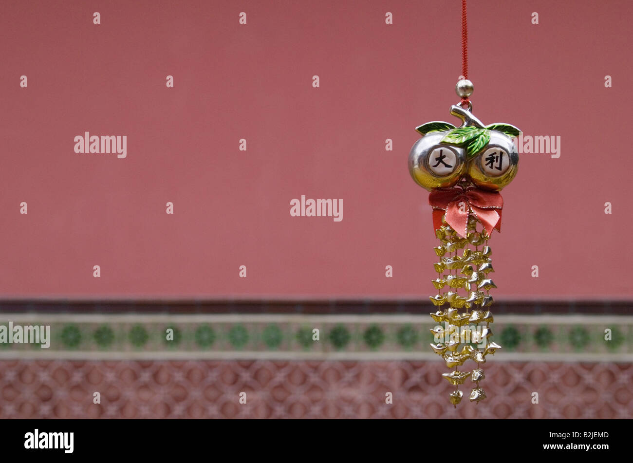 Ornate wind chime inside Thian Hock Keng Temple, the oldest Hokkien Chinese temple in Singapore - Stock Image