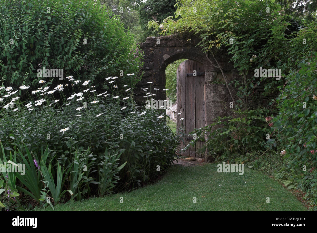 Open gate in country garden, England - Stock Image
