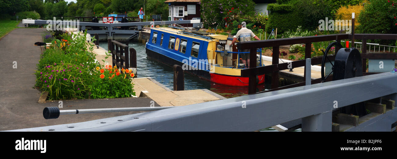 Narrowboat using St Johns Lock on the River Thames near Lechlade Stock Photo