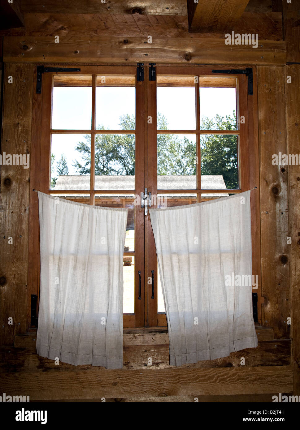 Wooden Frame Window In Log Cabin With Basic Curtains Fort Langley British Columbia Canada