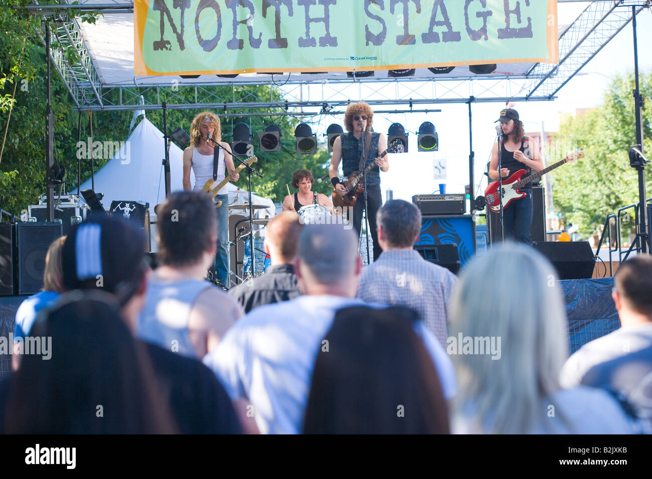 Photographs of rock and roll band Shim playing at the North stage at the 2008 West Seattle Street Fair - Stock Image