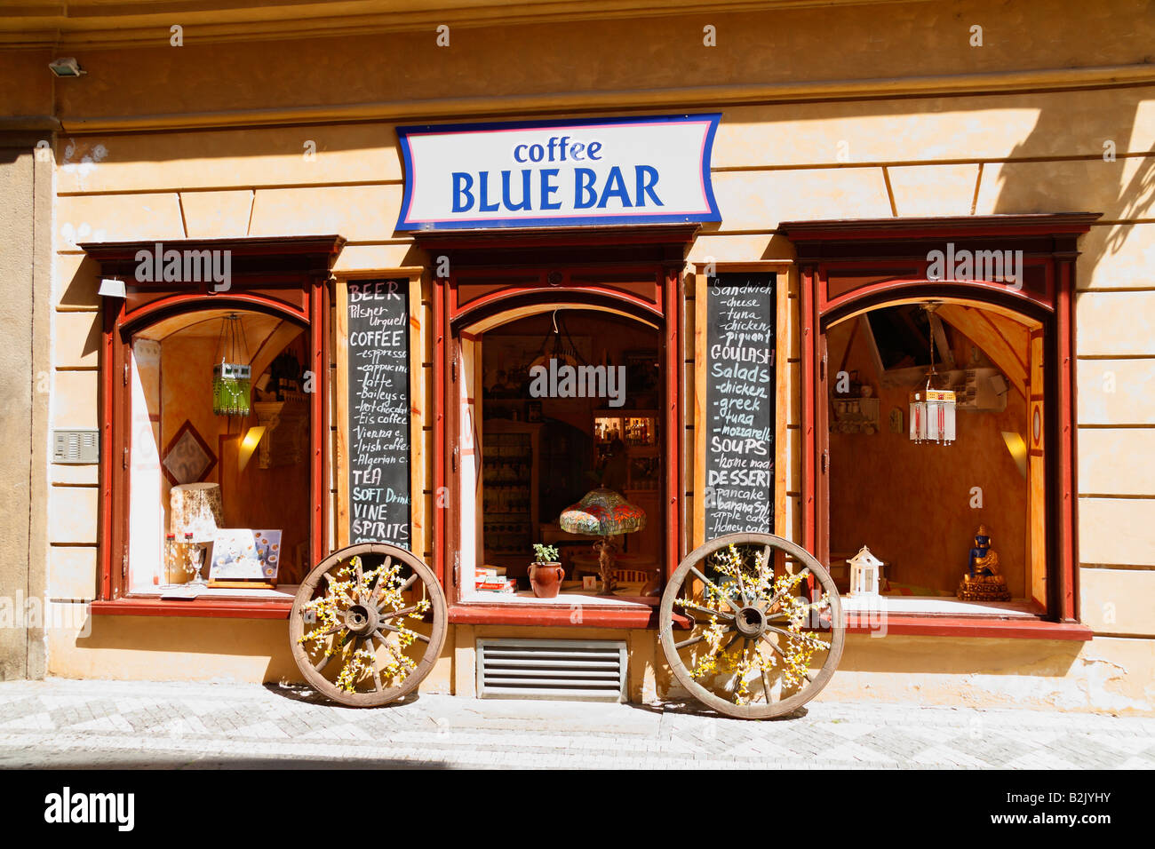 The Small Authentic Blue Bar Cafe Decorated With Old Horse Carriage Stock Photo Alamy