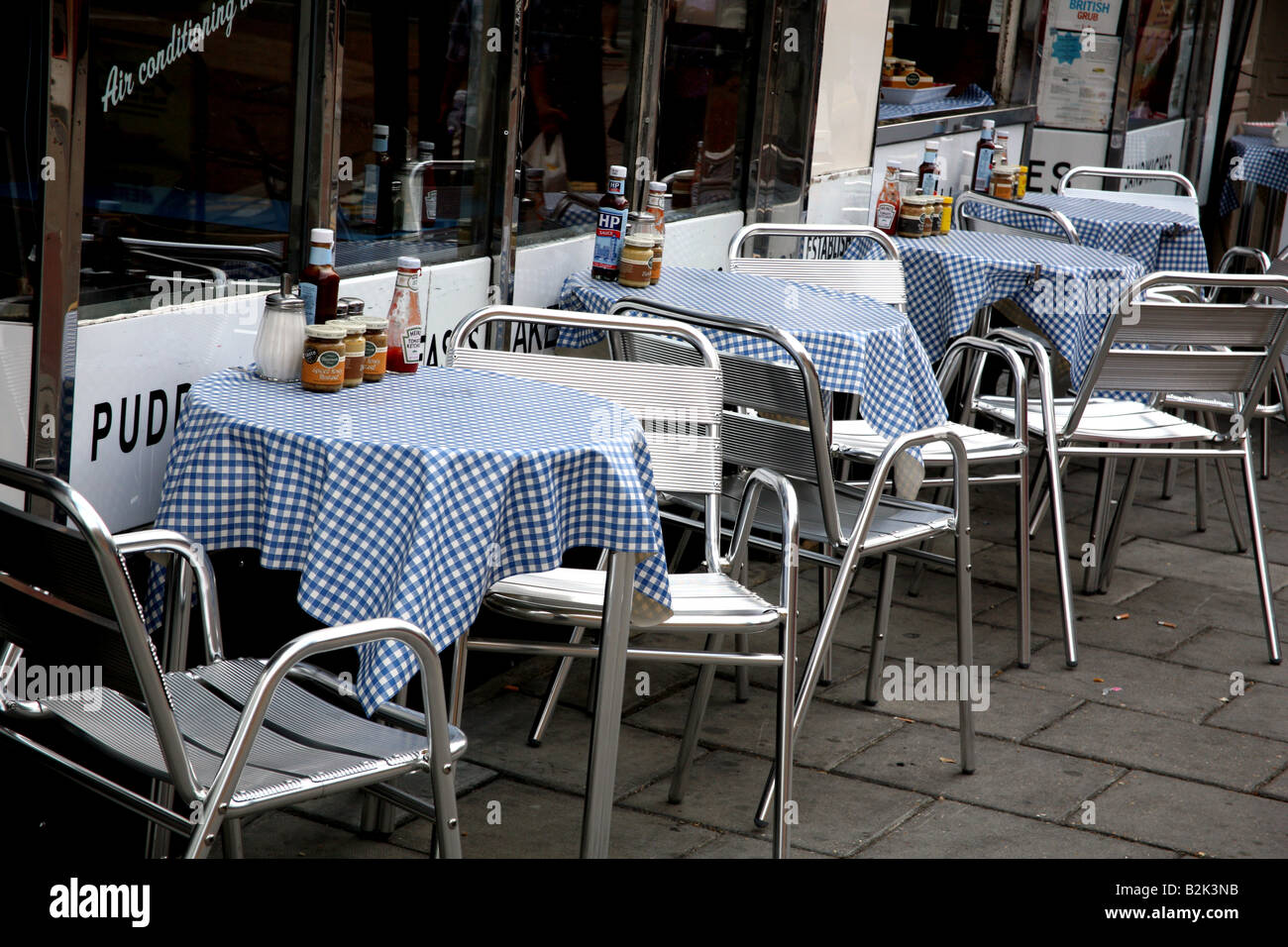 Empty restaurant tables in London during economic downturn - Stock Image