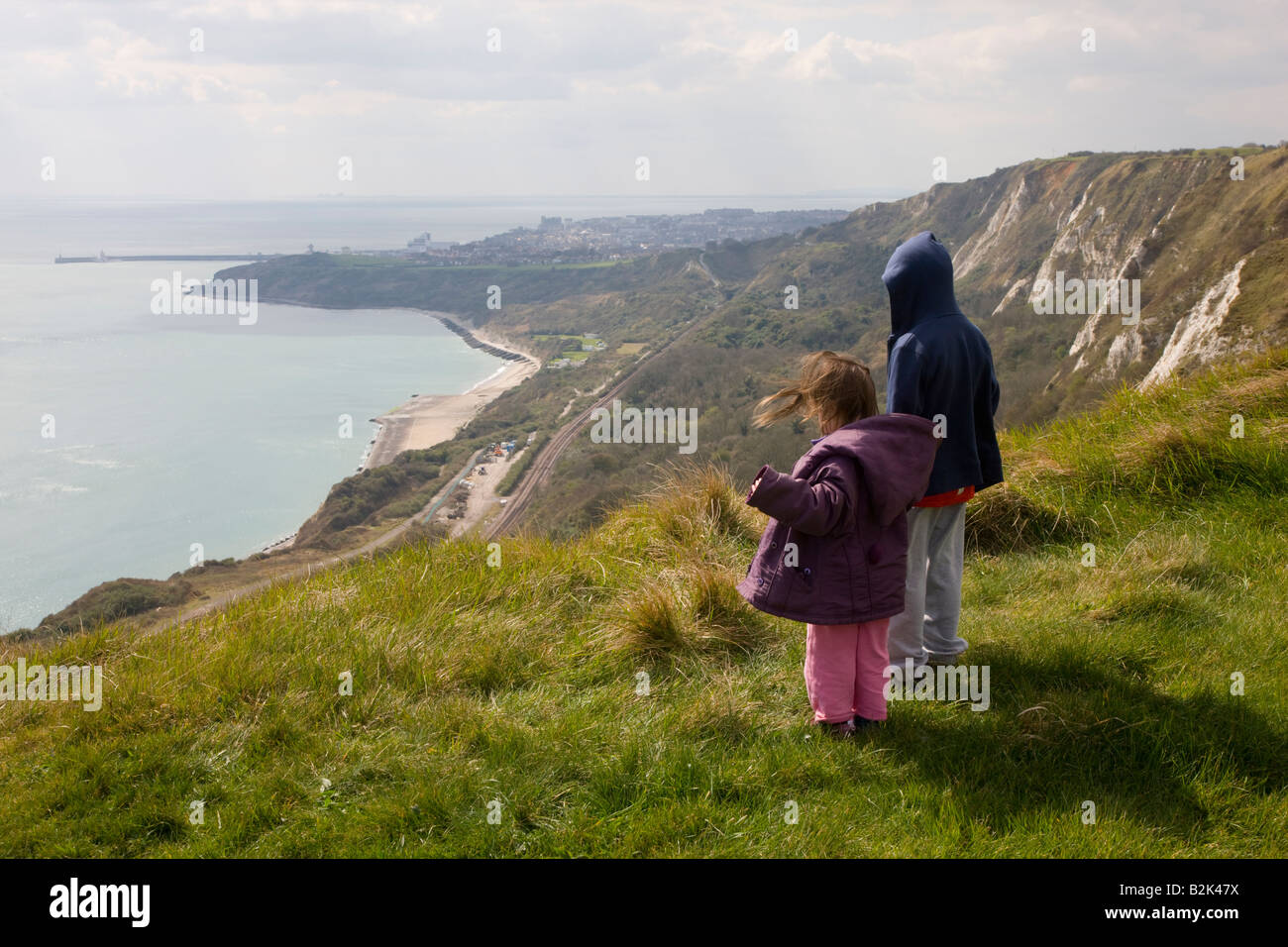 Family enjoying the view of Folkestone from the clifftops at Capel Le Ferne in Kent - Stock Image