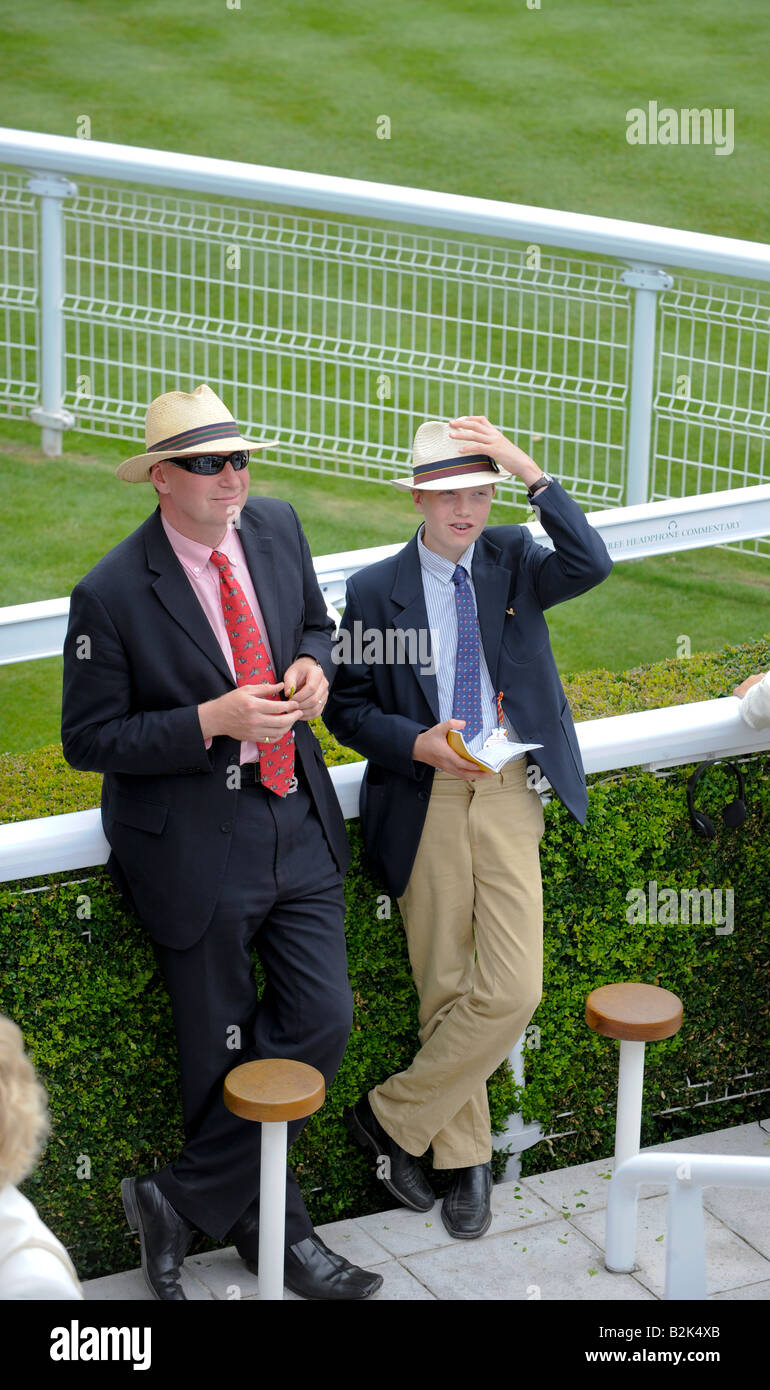 Glorious Goodwood: A father and son wearing panama hats on Ladies' day in the winners enclosure. - Stock Image