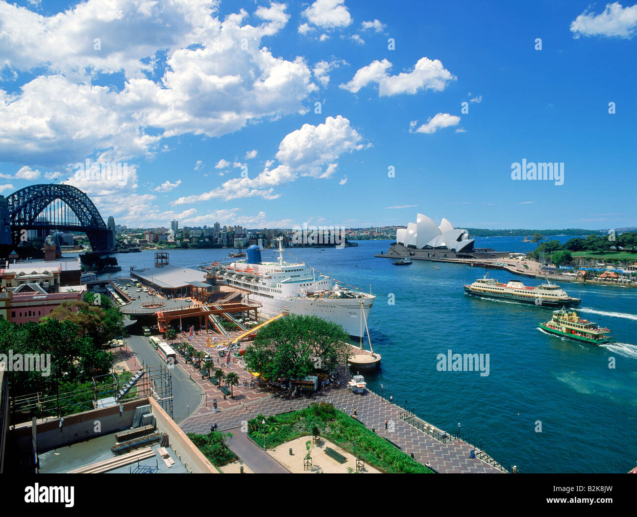 Passenger ship and ferryboats at the Sydney Harbor Quay with Opera House - Stock Image