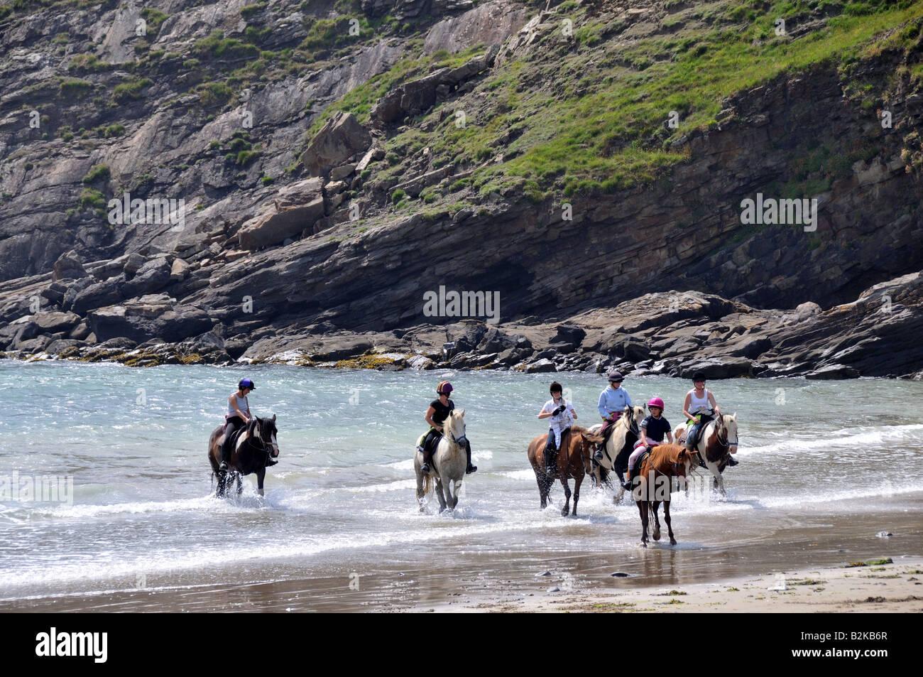 Horse riding on Little Hven beach Pembrokeshire Wales Cymru - Stock Image