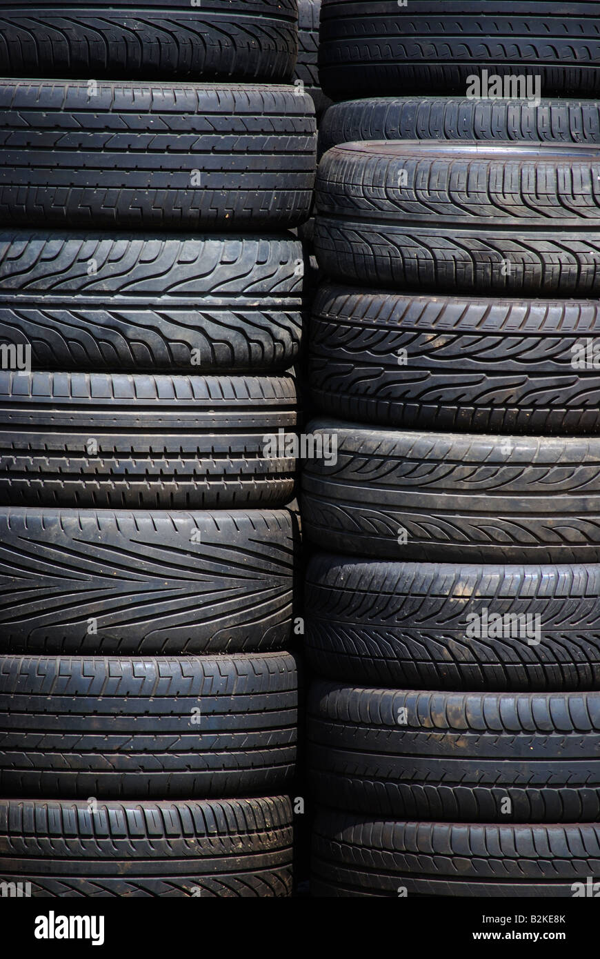 Used Tyres stacked - Stock Image