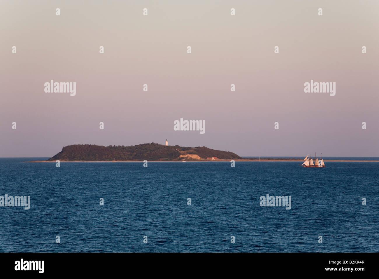 Wooden boat passing Hjelm Island in Kattegat, Denmark - Stock Image