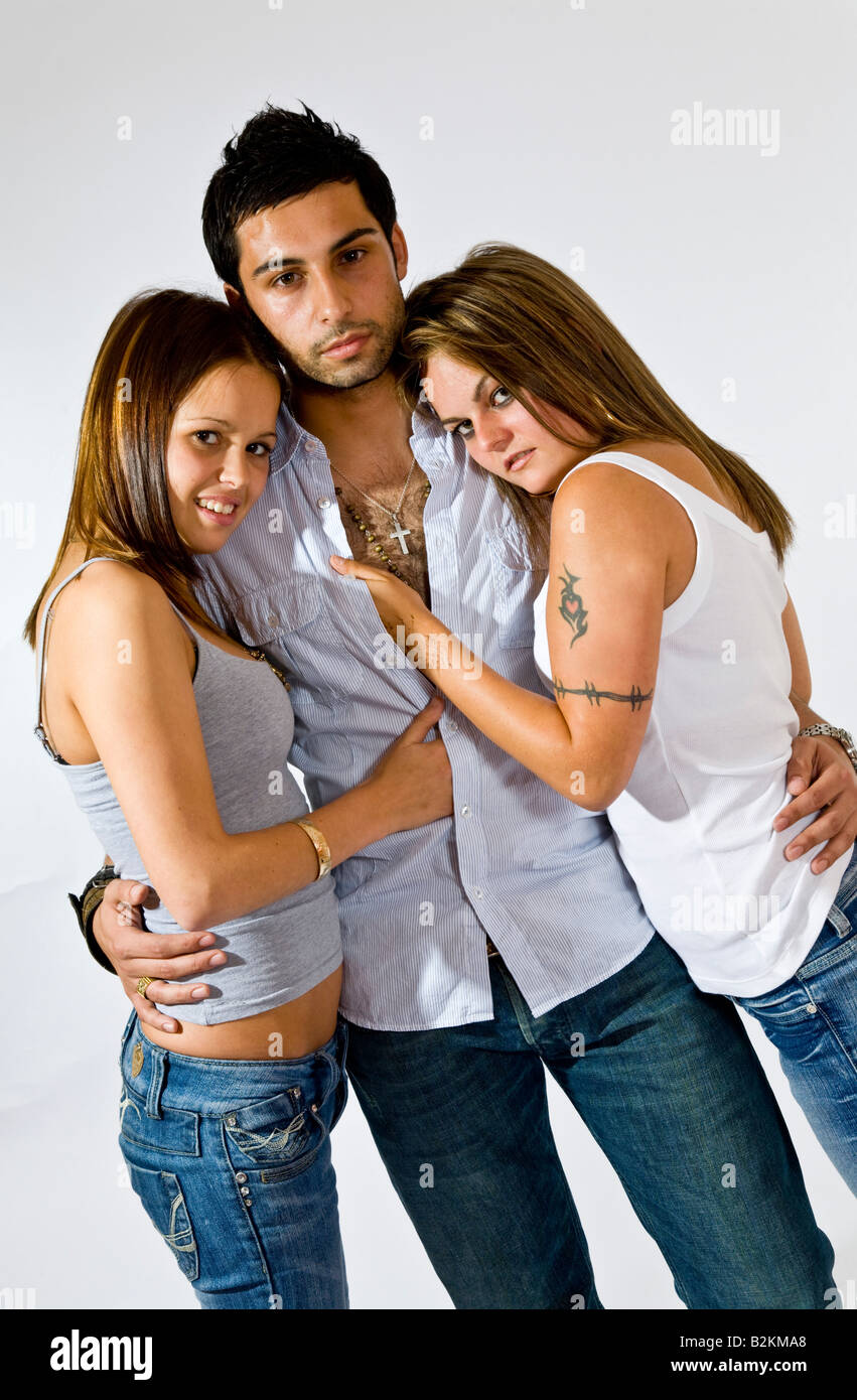 A Young Man With His Arms Round Two Sexy Young Women