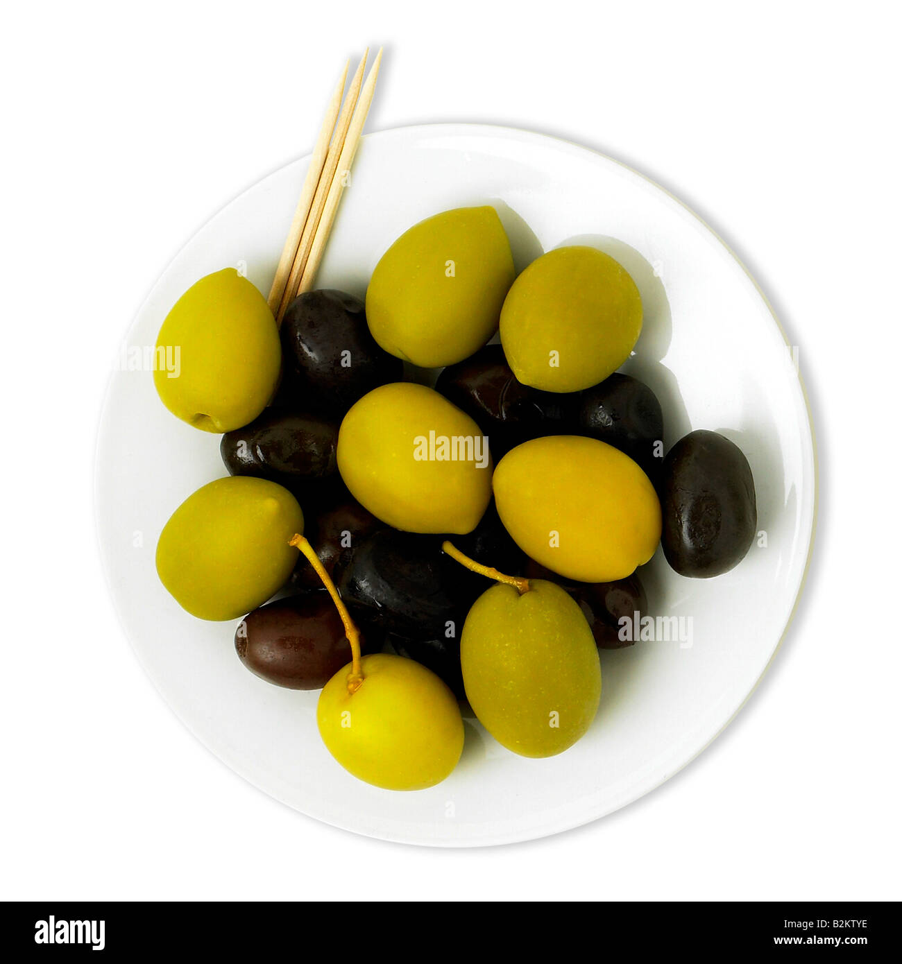 White tray with black and green olives and toothpicks - Stock Image