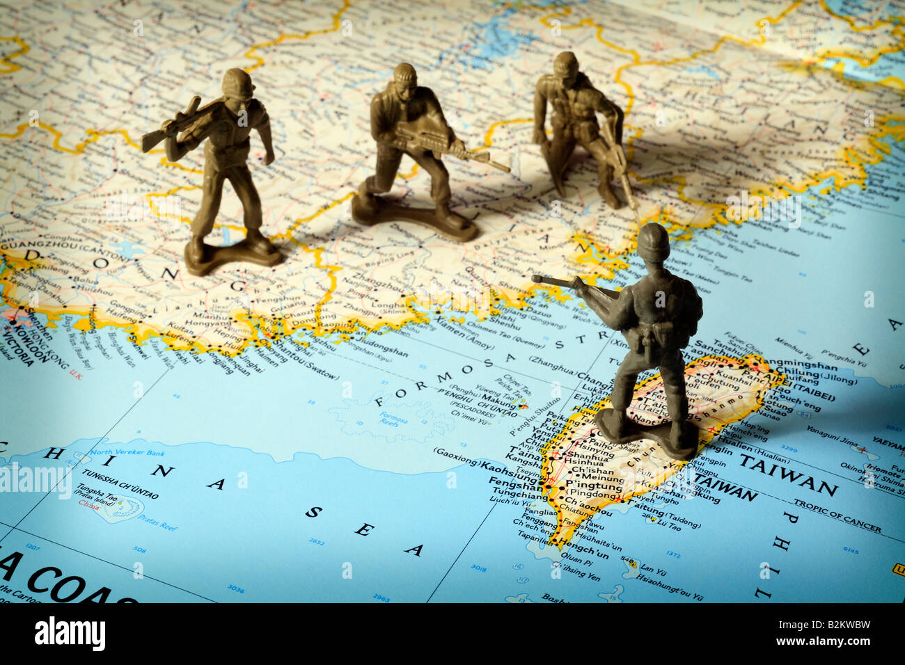 Toy soldiers on map of China and Taiwan face off - Stock Image