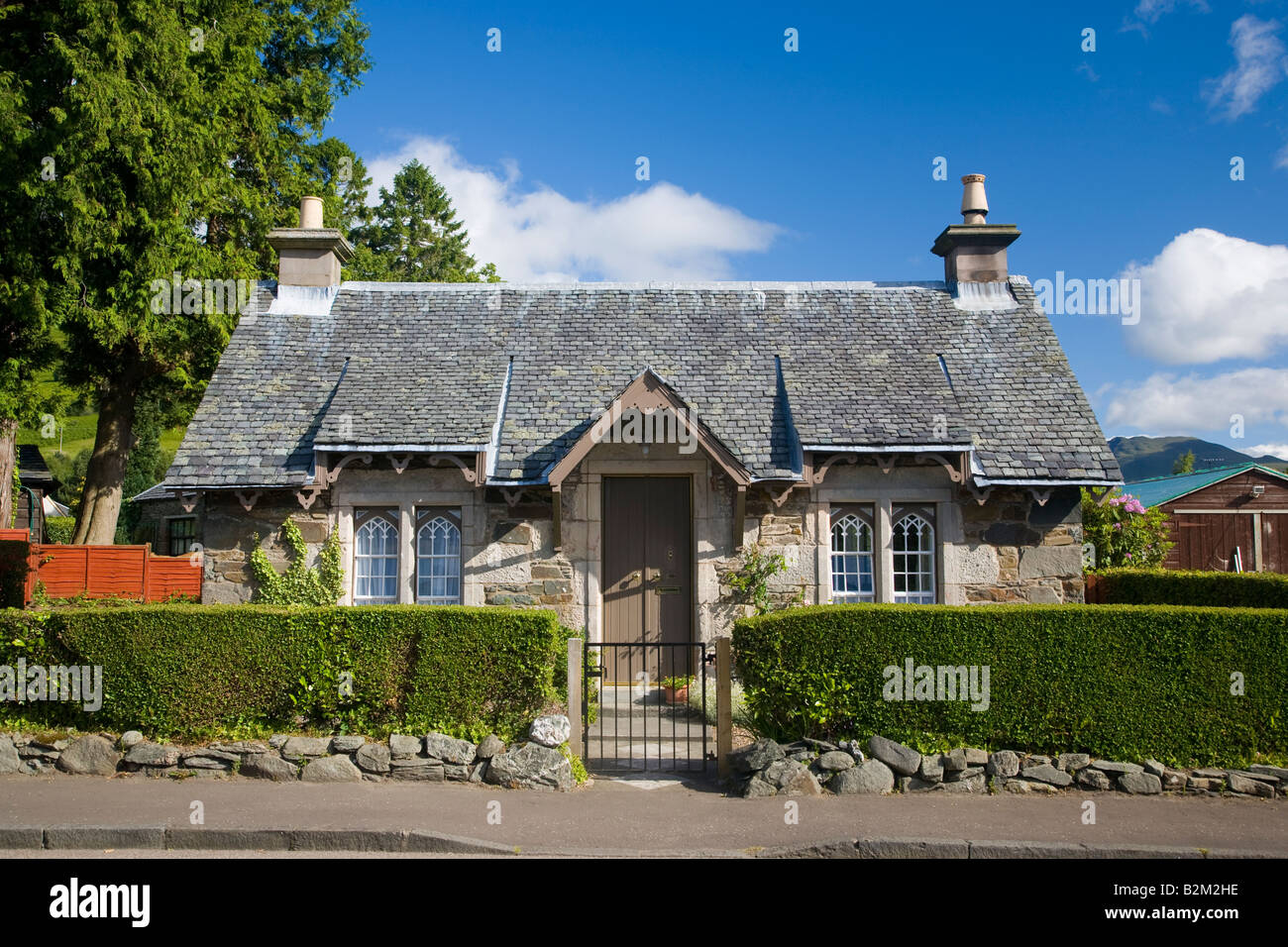 Traditional cottage Luss Scotland - Stock Image