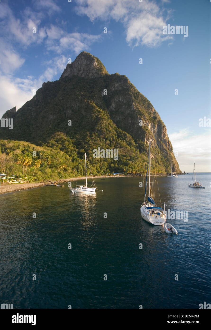 Cruising sailboats anchored below Petit Titon St Lucia West Indies Stock Photo