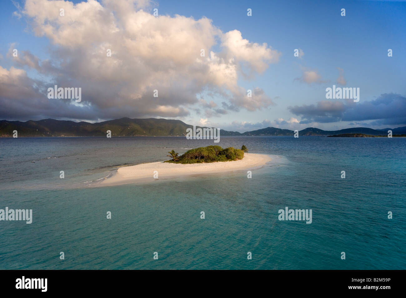 The small deserted island of Sandy Spit British West Indies This is a rare view of the normally crowded island - Stock Image