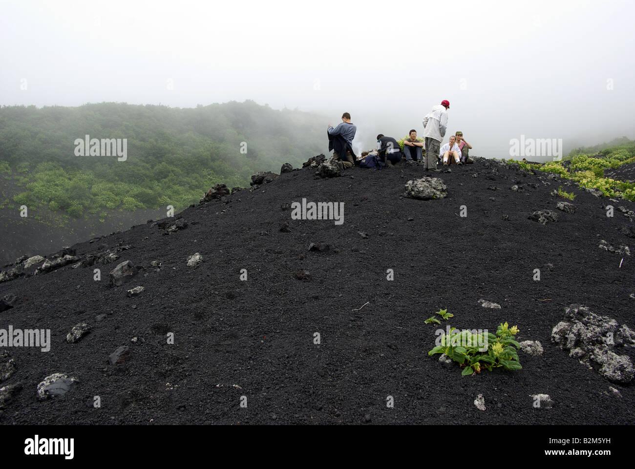 People are climbing on volcano Tya Tya, Kunashir island, Kuril islands Far East of Russia - Stock Image