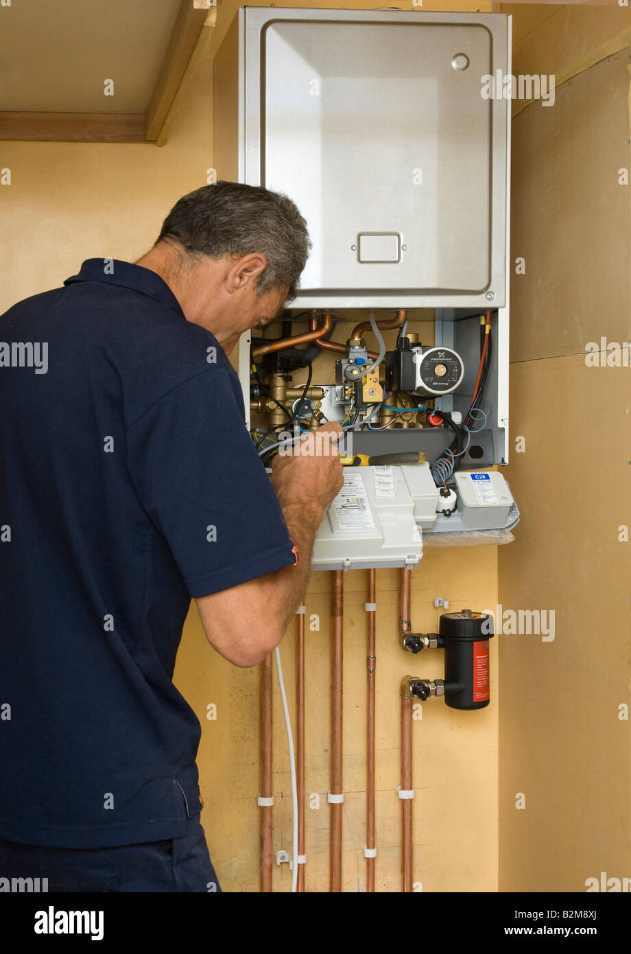 man working on a gas boiler Stock Photo: 18885738 - Alamy