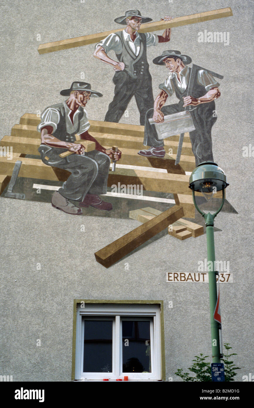 Kunst am Bau Mural on a German house wall carpenters Example of national socialist art - Stock Image