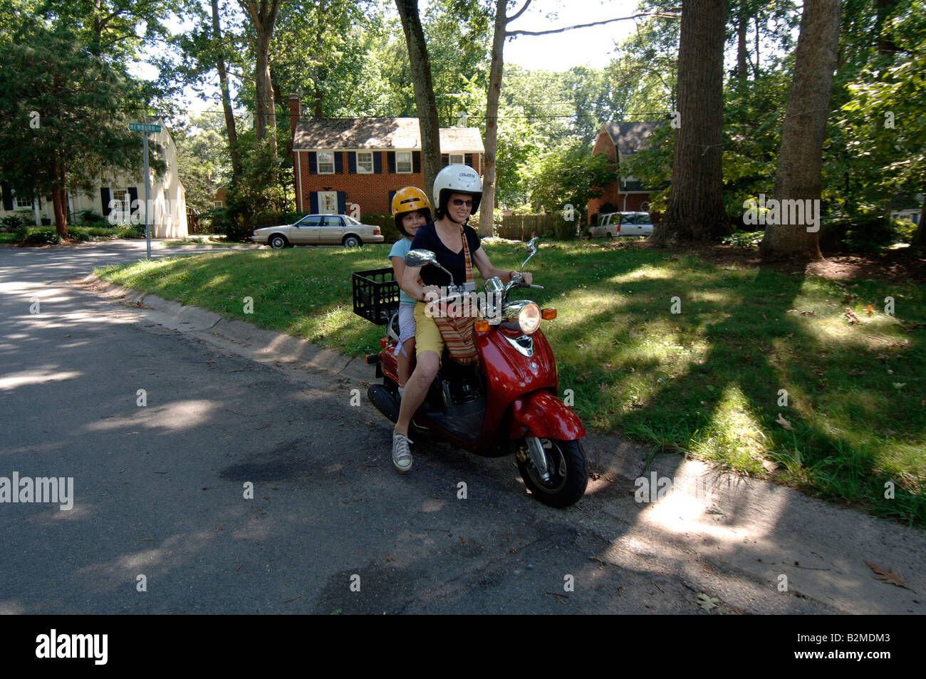 Woman and 7 year old ride Yamaha Vino scooter Stock Photo: 18889475 ...