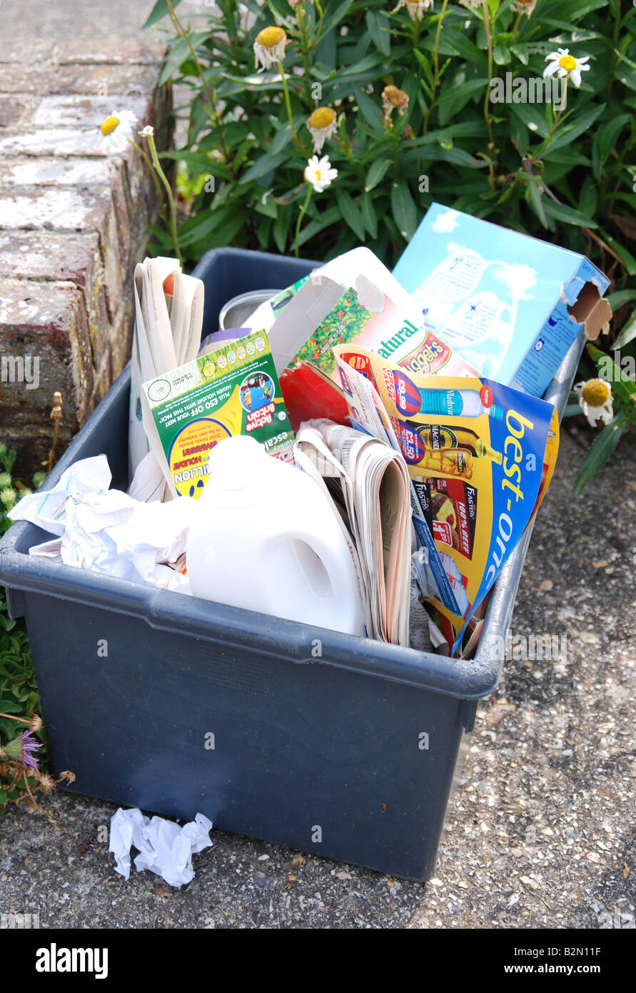 recycling bin filled with newspapers and  plastics for kerbside collection Worthing West Sussex Stock Photo