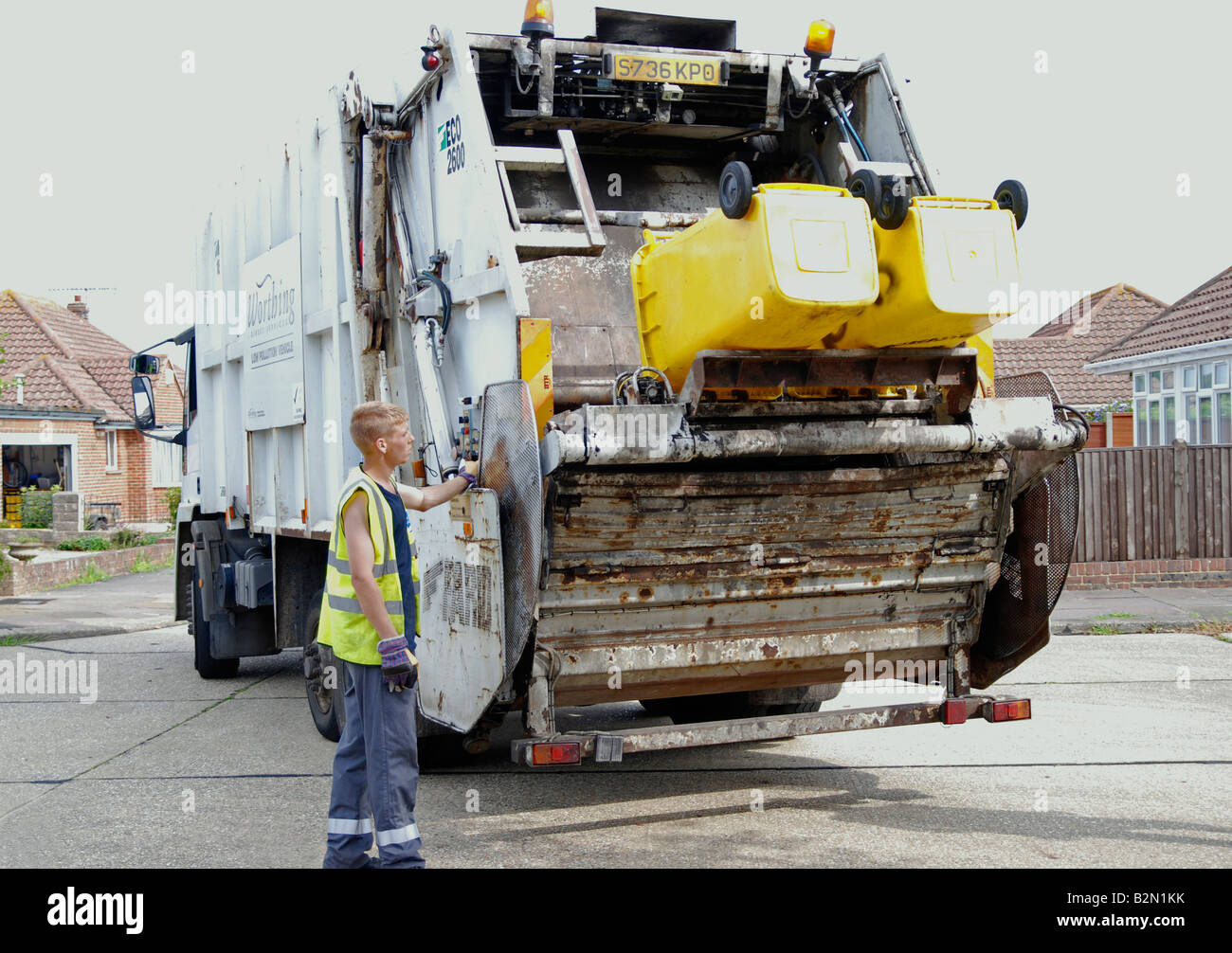 dustman colllecting rubbish for landfill Worthing Adur area West Sussex - Stock Image