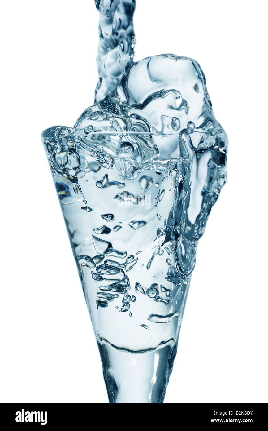 fresh running water into a drinking glass Stock Photo
