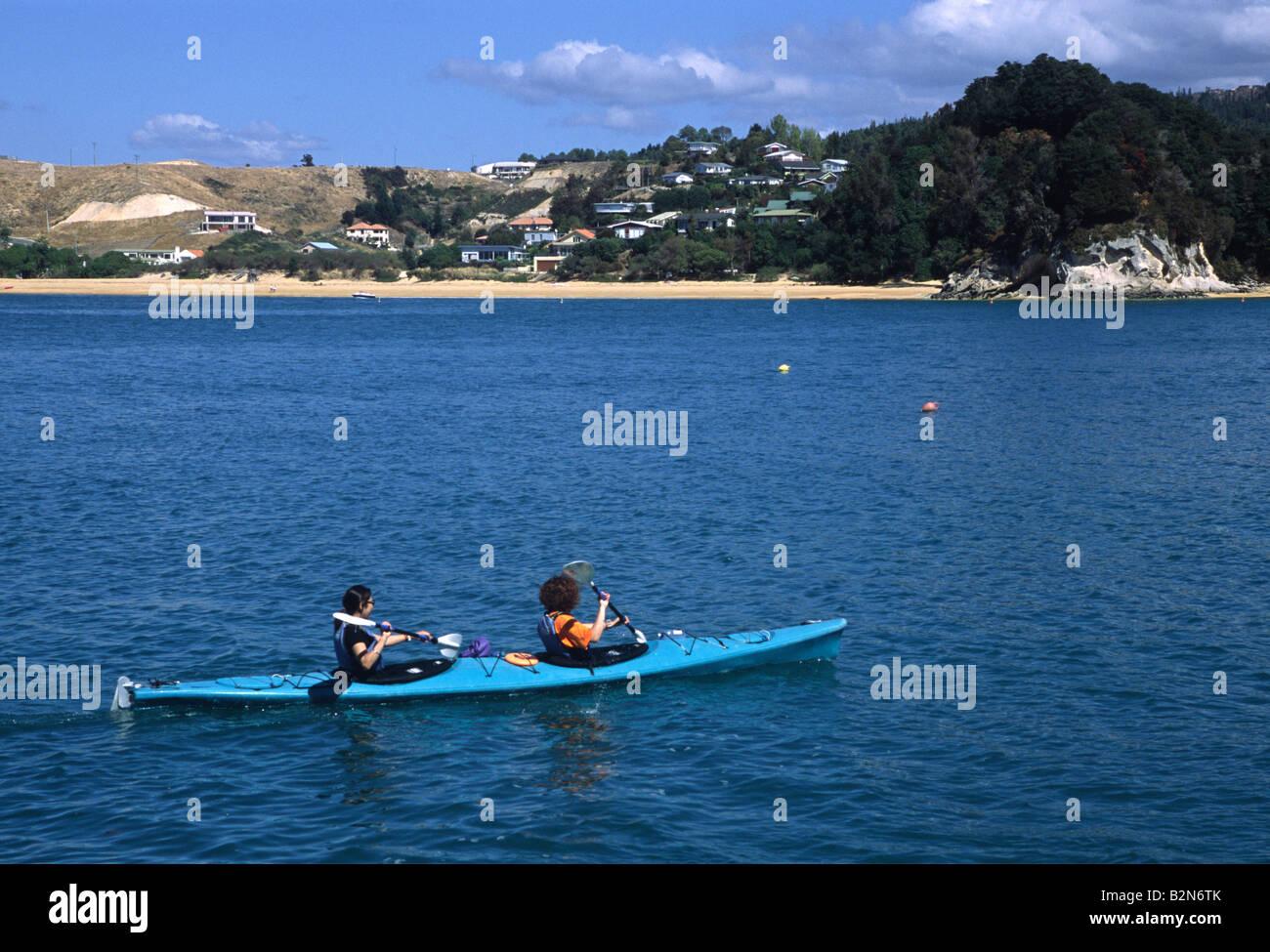 paddling canoes NZ - Stock Image