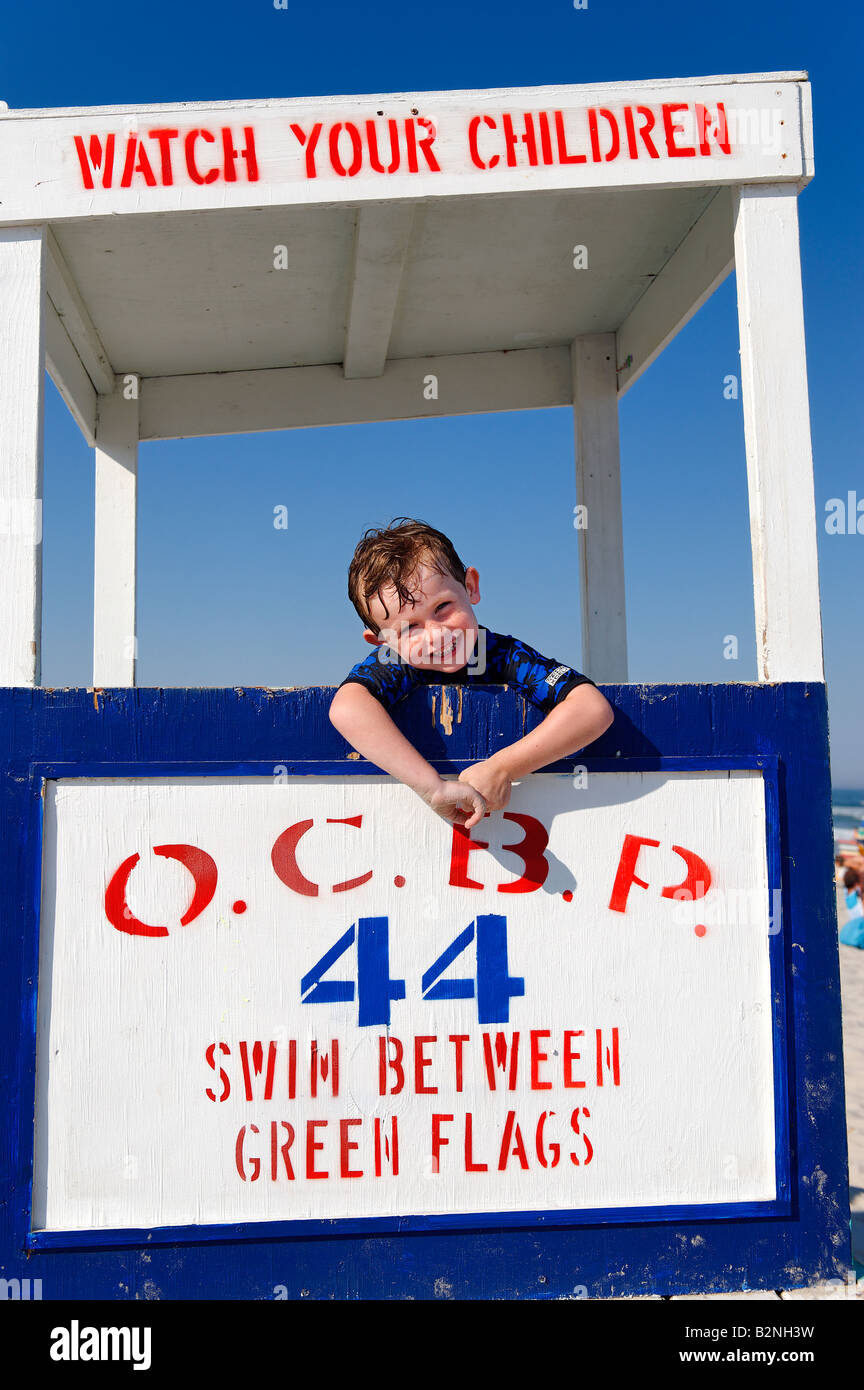 Portrait of a boy on a lifeguard stand at the beach Ocean City New Jersey USA - Stock Image