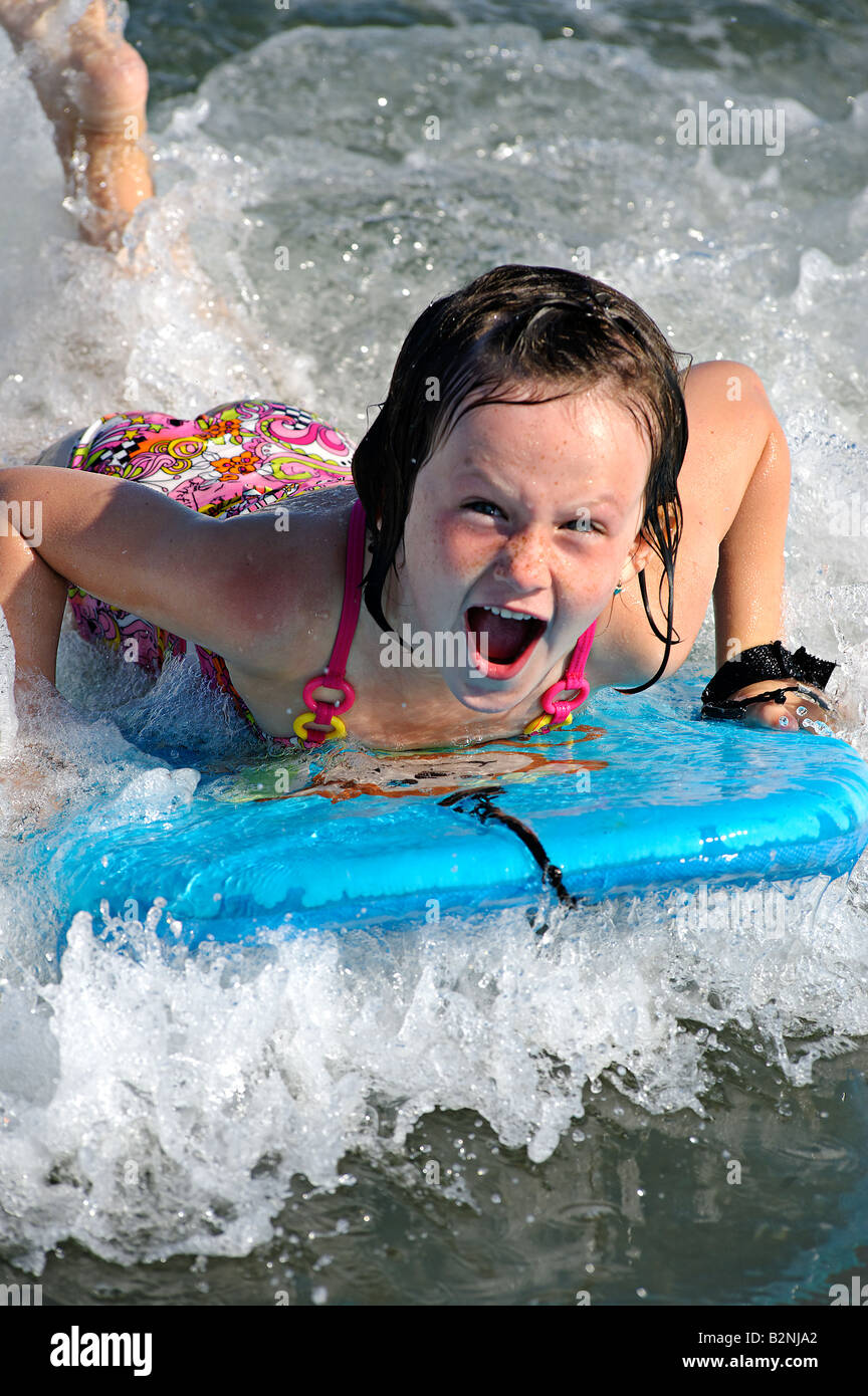 Girl on a wave board enjoying the ride Ocean City, New Jersey, USA - Stock Image