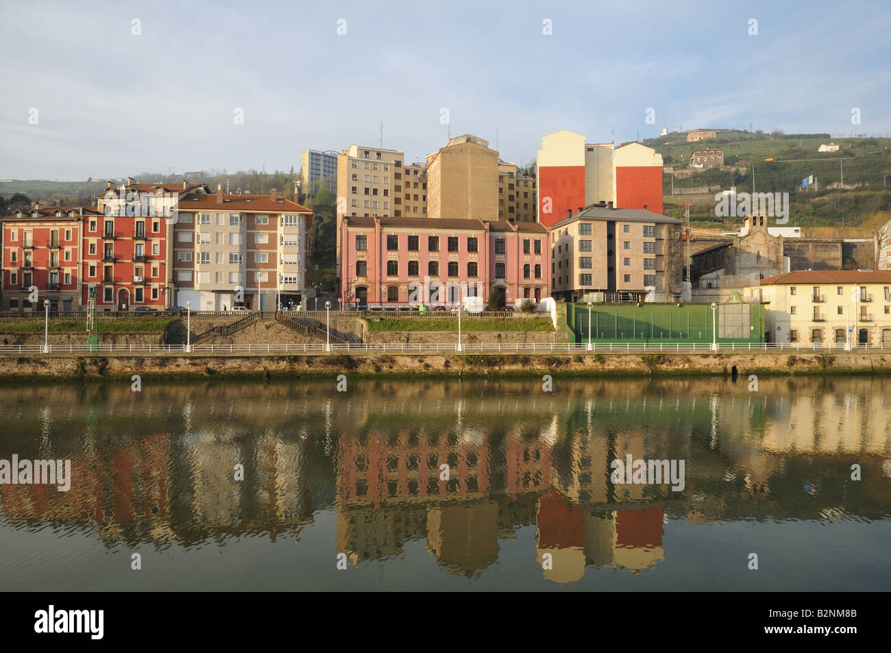 High rise flats apartments houses buildings seen across the Ria de Bilbao or Nervion River Spain - Stock Image