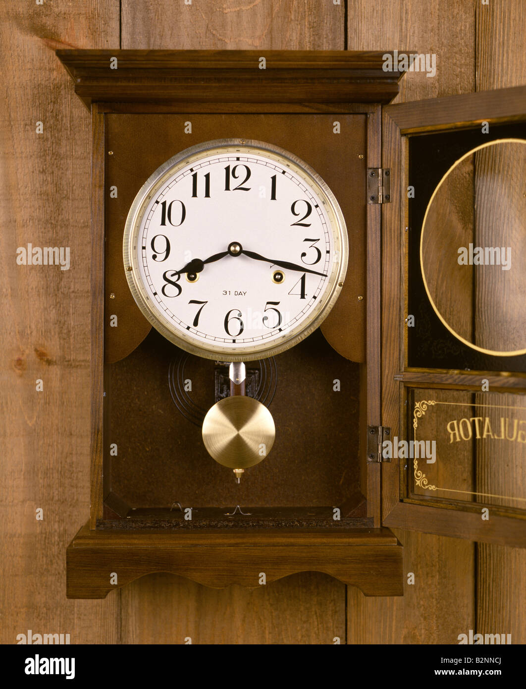 ANALOG CLOCK WITH PENDULUM - Stock Image