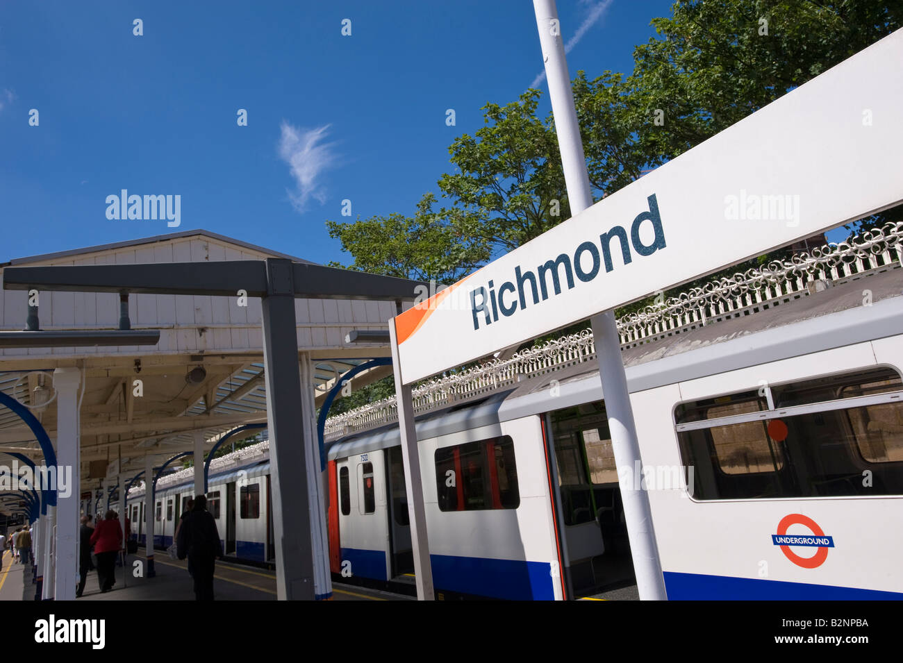 District Line train arriving at the station Richmond TW10 Surrey United Kingdom - Stock Image