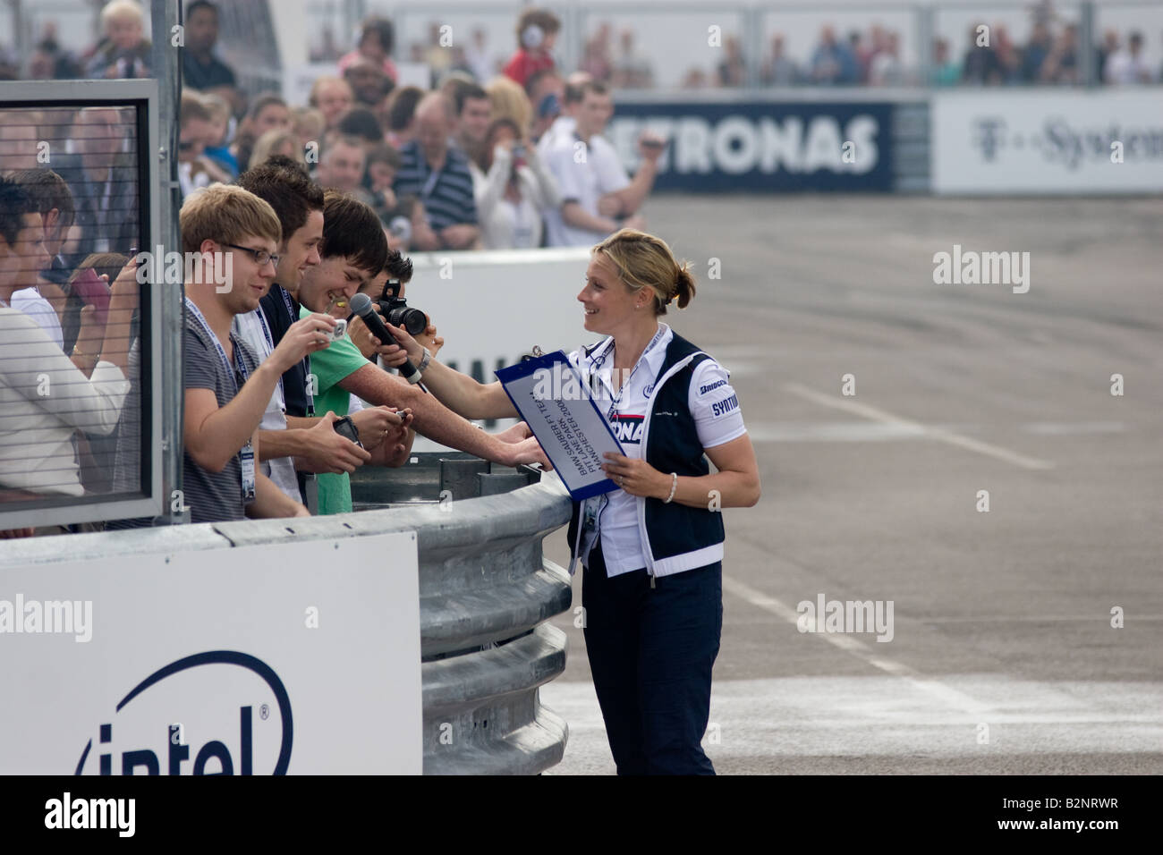 Vicky Butler Henderson interviewing the crowd at the BMW Sauber F1 Pit Lane Park at the Trafford Centre in Manchester - Stock Image
