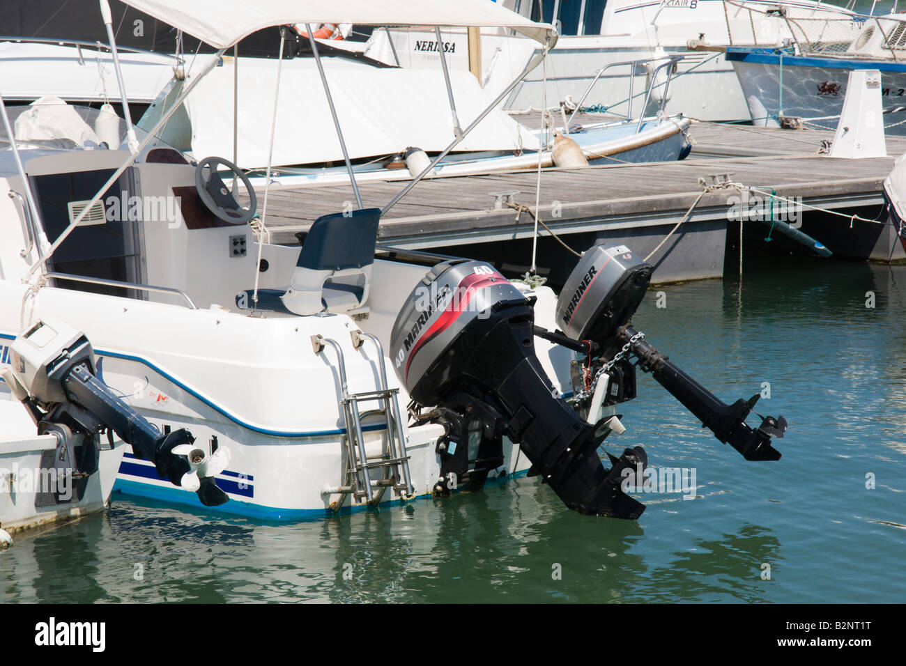 Costa Blanca Spain twin or dua outboard motors on boat Mariner brand - Stock Image