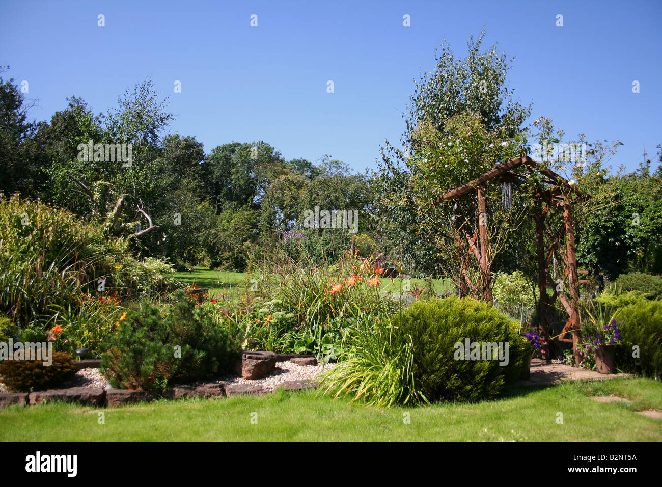 An English country garden in summer - Stock Image