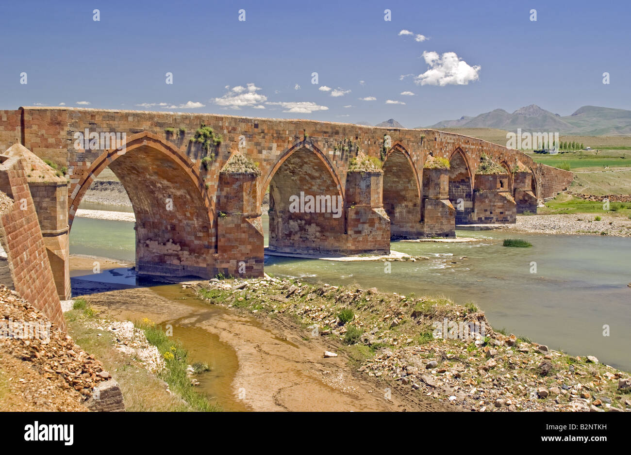13th Century Ottoman Cobandede Bridge over Aras River between Pasinler and Horasan - Stock Image