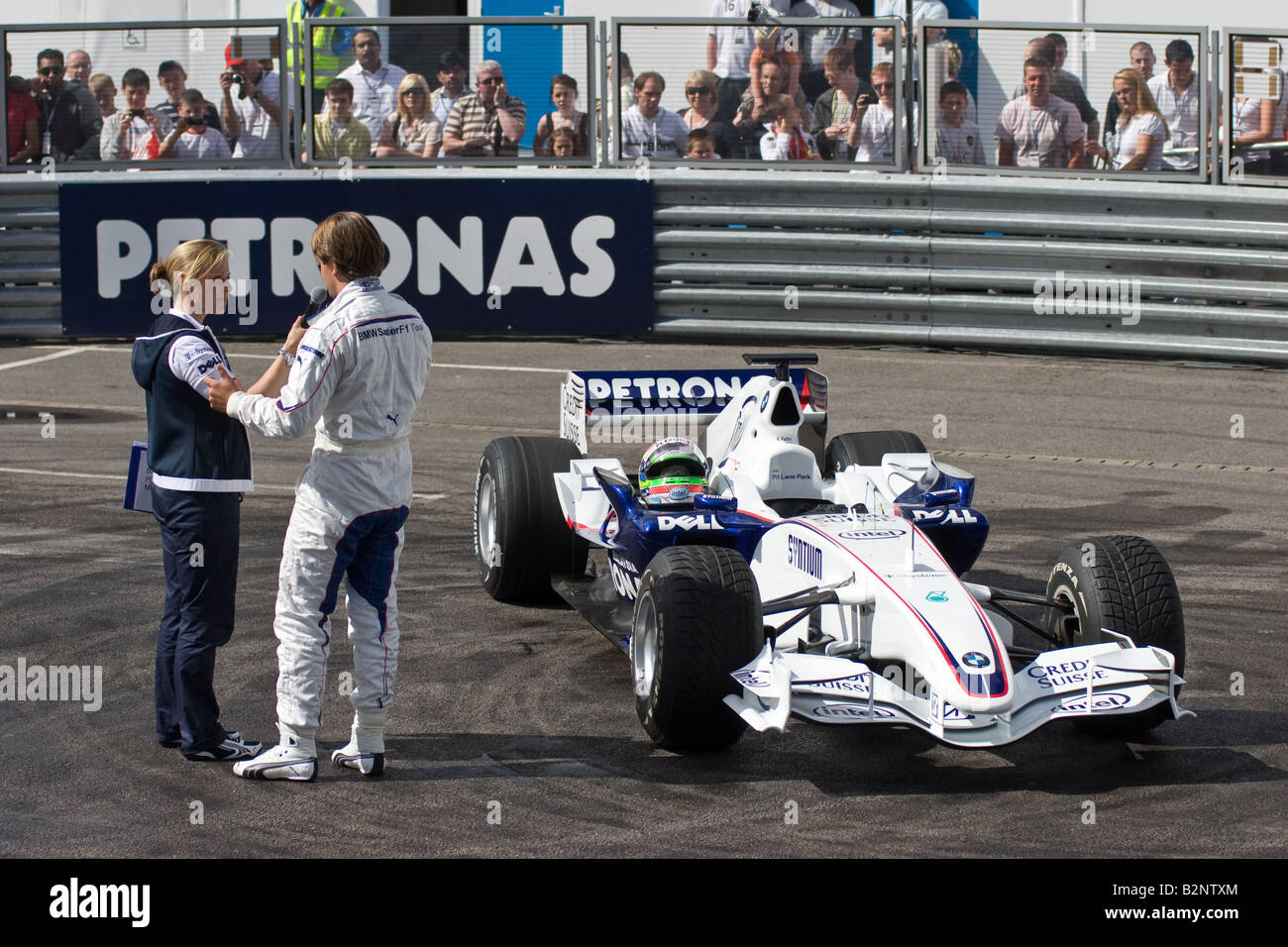 Augusto Farfus being interviewd by Vicky Butler Henderson at the BMW Sauber Pit Lane Park - Stock Image