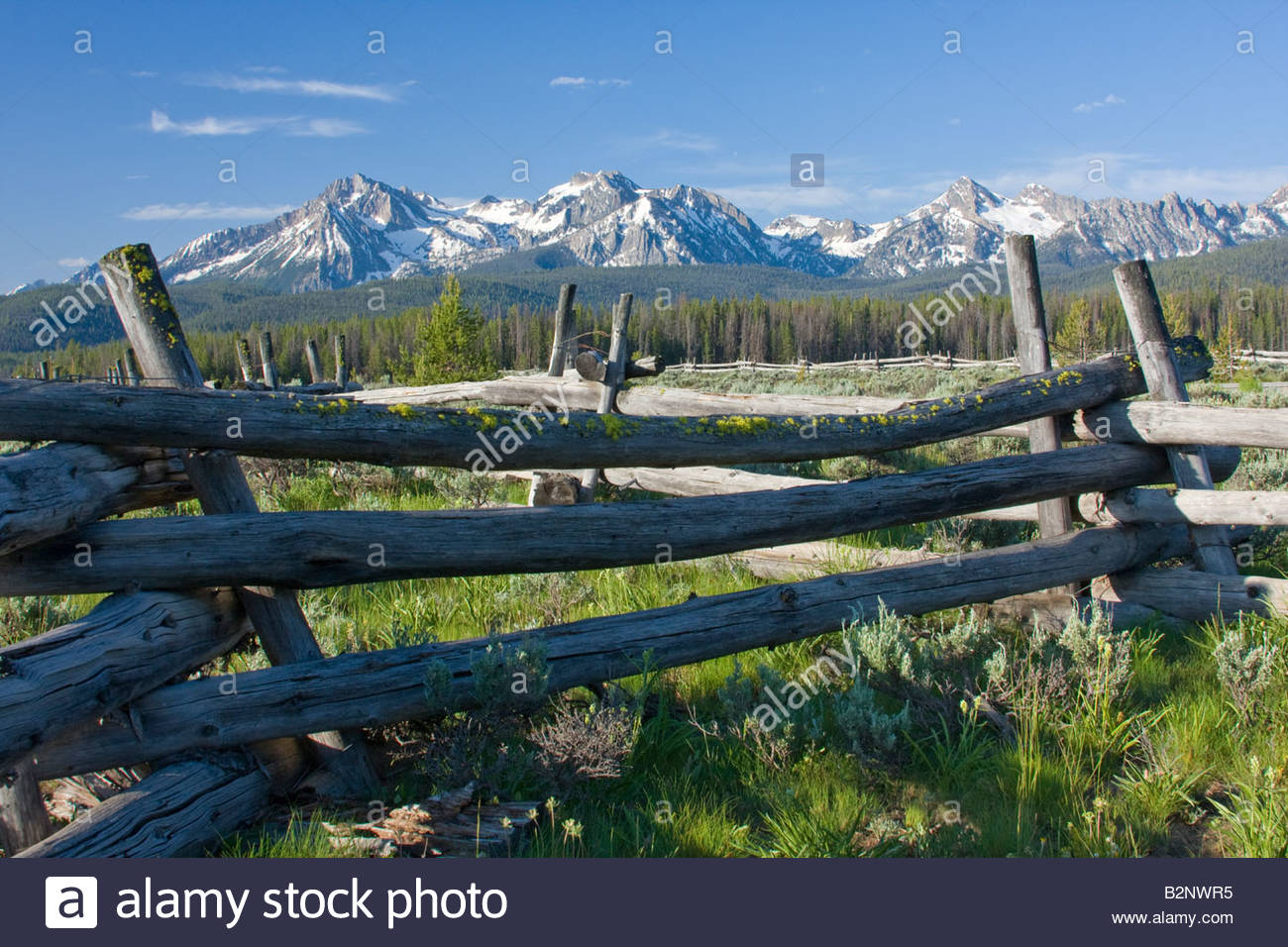 The Sawtooth Range and rustic fence seen from Stanley Creek Wildlife Interpretive Area on Hwy 21, Idaho. - Stock Image