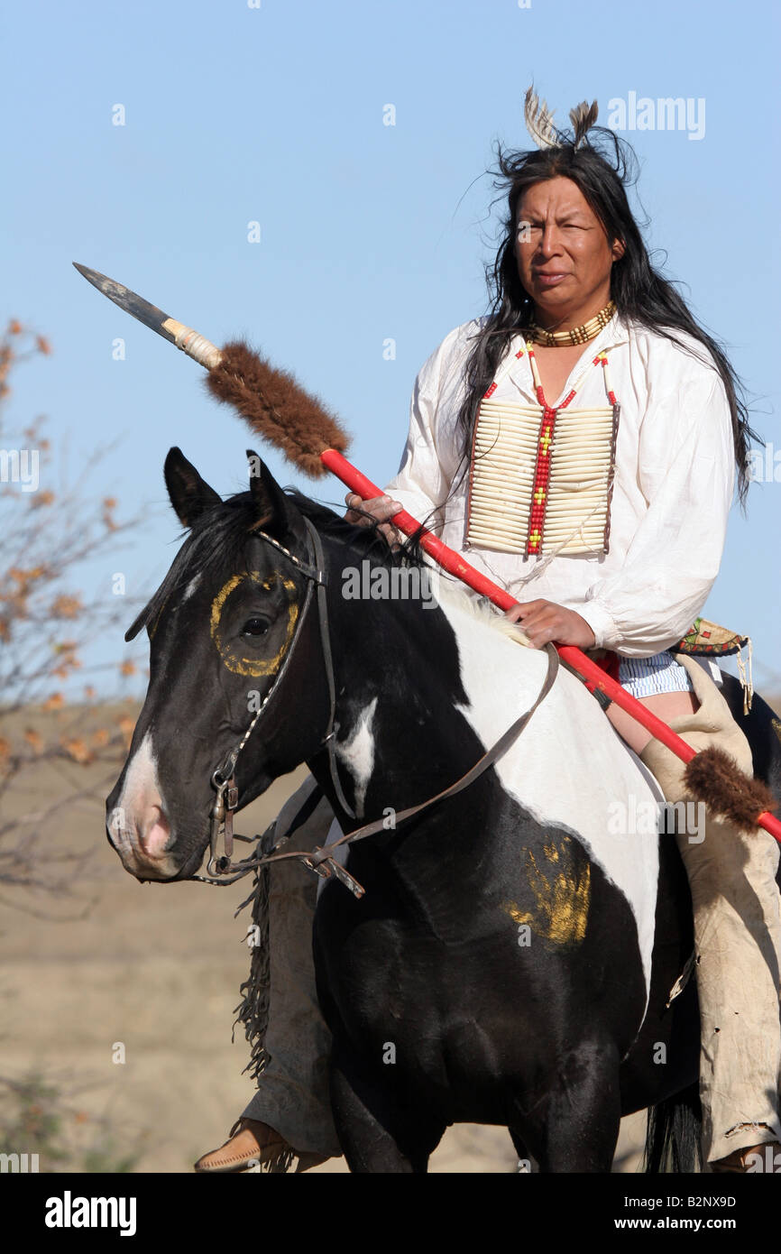 A Native American Sioux Indian on Horseback with a spear - Stock Image