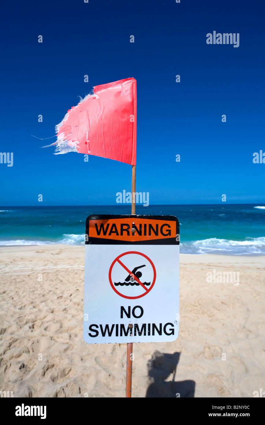 Danger No swimming Beach Closed Sign Sunset Beach North Shore Oahu Hawaii Stock Photo